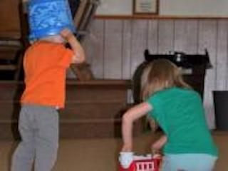 kids playing with buckets